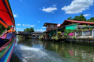 Liquid Bangkok - Doi Kanong with train in backhground over canal